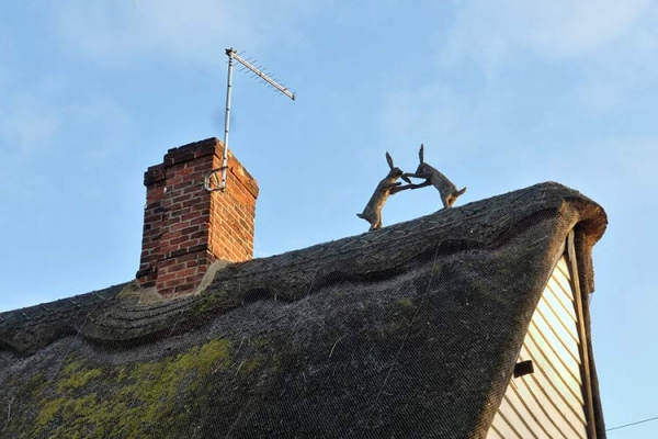 about-us-thatch-chimney
