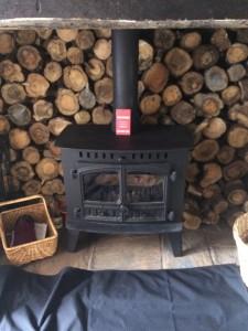 Logs round stove - Mark Hagon